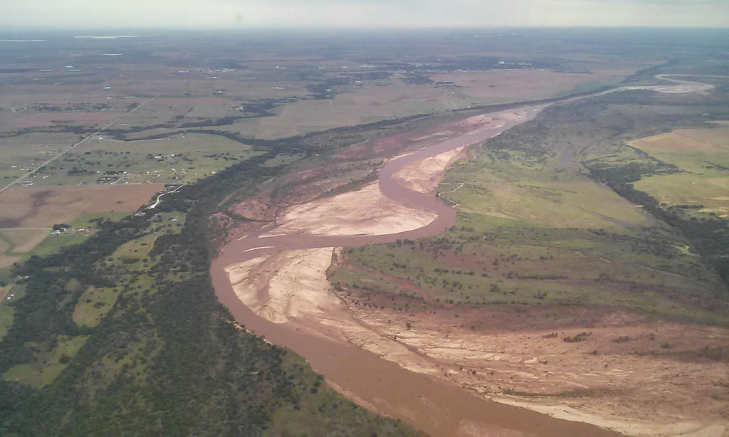Red River after a recent flood, en route to a crane work site
