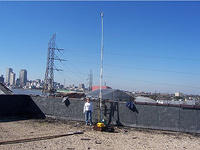 EMO Energy Solutions is installing a wind anemometer atop a four story historical building near downtown New Orleans