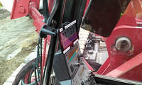A dash mount attached the touch screen tablet for in-cab display and cellular communications